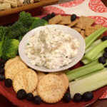 This is an Herbed Cream Cheese and Walnut Spread served with crackers. Recipe is from recipesworthrepeating.com