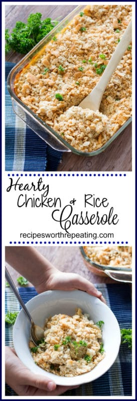 Glass Pyrex dish containing a hearty Chicken and Rice Casserole topped with parsley, serving spoon in casserole.