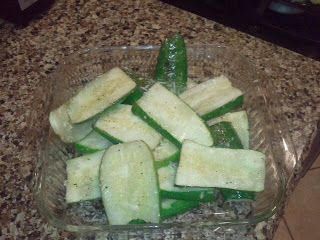 A dish of sliced zucchini prior to being put on a grill.