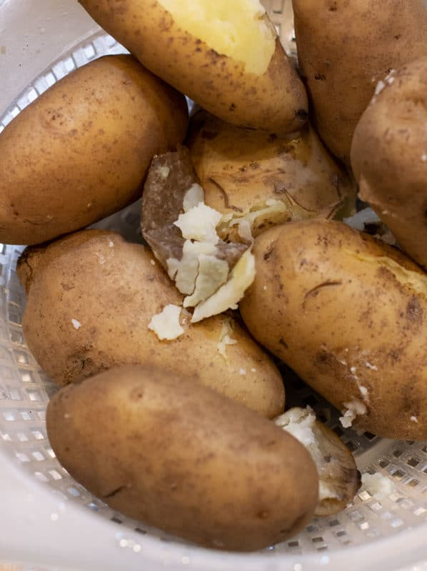 Cooked Idaho Potatoes ready to be peeled.
