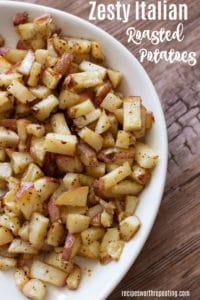 White bowl containing roasted potatoes.