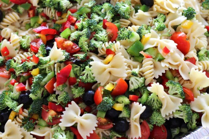 Italian Style pasta salad containing tomatoes, peppers, cheese and broccoli.