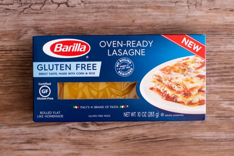 Box of Barilla Oven-Ready gluten free lasagne noodles sitting on a brown table.