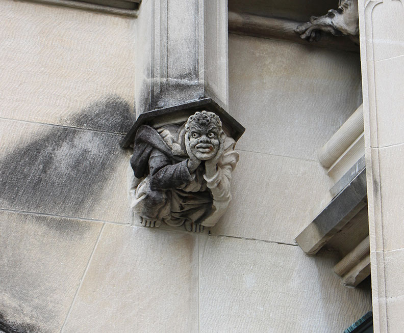 A statue on the side of a building.
