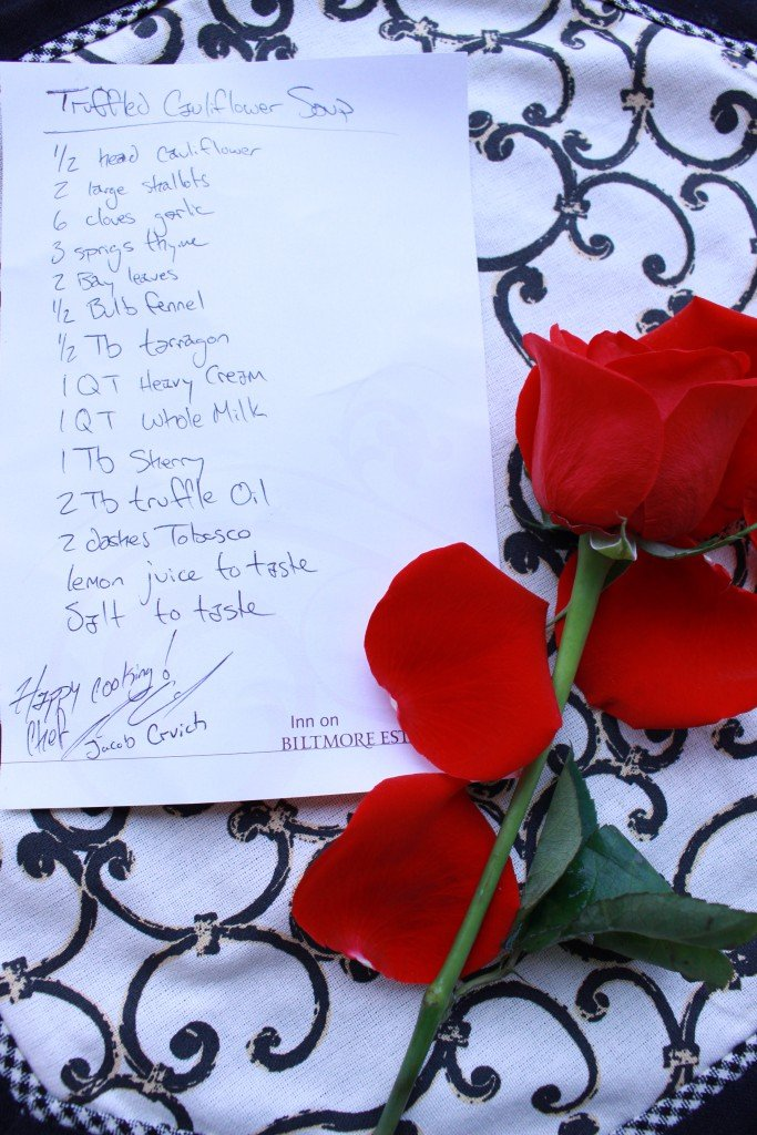 A close up of a rose with a handwritten recipe.