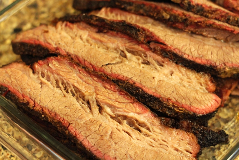 Slices of beef brisket with a thick smoke ring.
