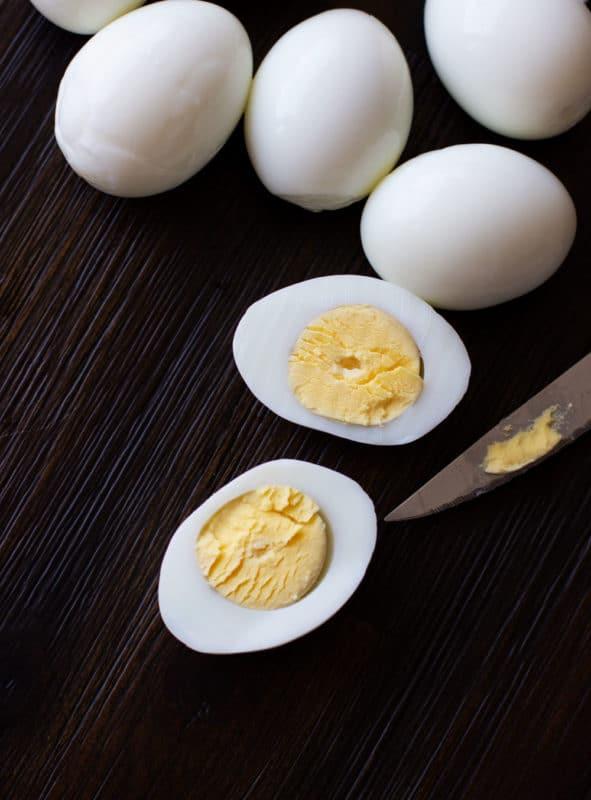 Sliced hard boiled egg lengthwise.