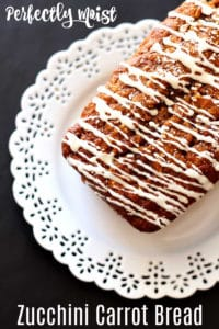 Zucchini Apple Bread topped with butter rum glaze on a white lace plata.