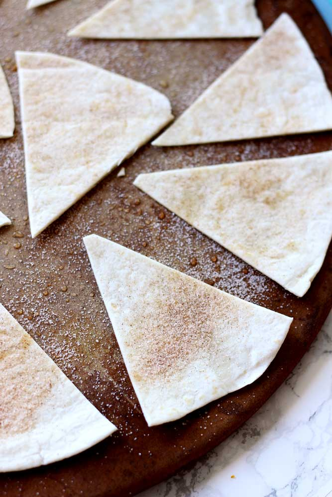 A close up of baked tortillas cut in triangles
