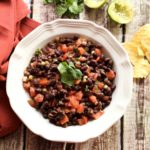 This is a picture of a bowl of black bean dip. Recipe at recipesworthrepeating.com
