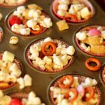 This is a picture of a Popcorn Snack Mix. Recipe at recipesworthrepeating.com