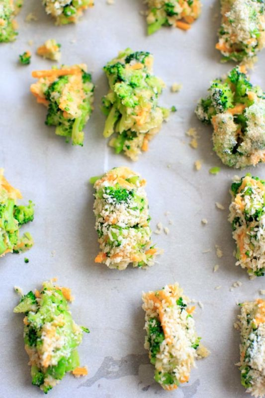 12 baked broccoli and cheddar bites on a silver sheet pan.