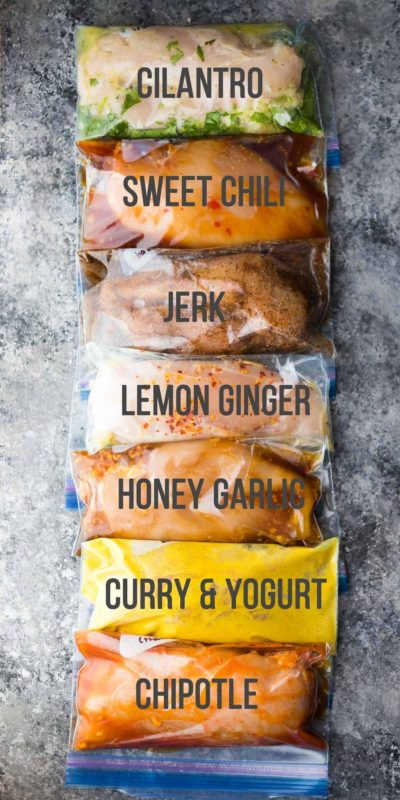 7 individual ziplock bags containing a single chicken breast with cilantro, sweet chili, jerk, lemon ginger, honey garlic, curry & yogurt and chipotle marinade.
