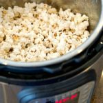 An Instant Pot containing fresh popped popcorn.
