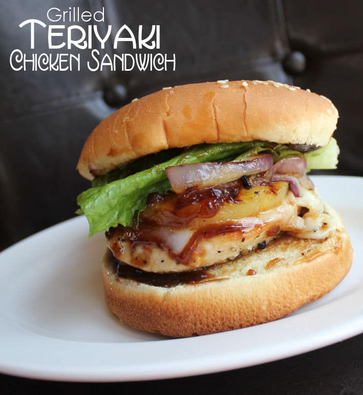 Teriyaki Chicken Sandwich containing sliced pineapple, sauteed onion, lettuce and bun sitting on a white plate.