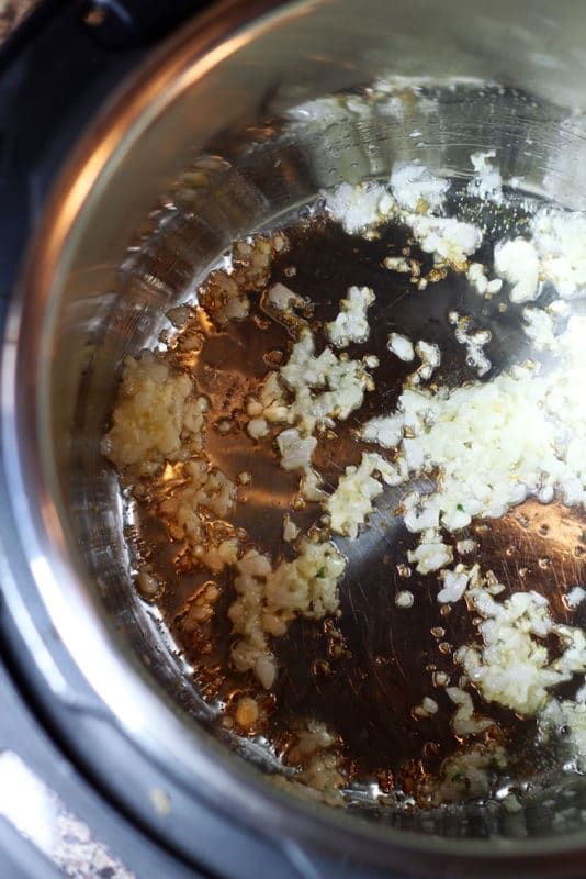 Sauteed garlic and onions in Instant Pot.