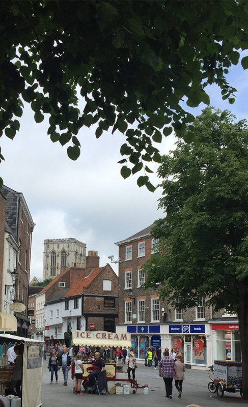 Picture of a town in England featuring the pharmacy store Boots.