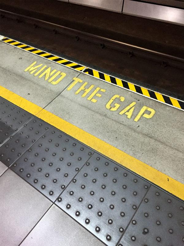 Mind The Gap painted in a tube floor in London.