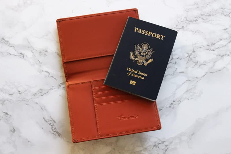 Orange RFID Passport cover with a blue United States of America Passport.
