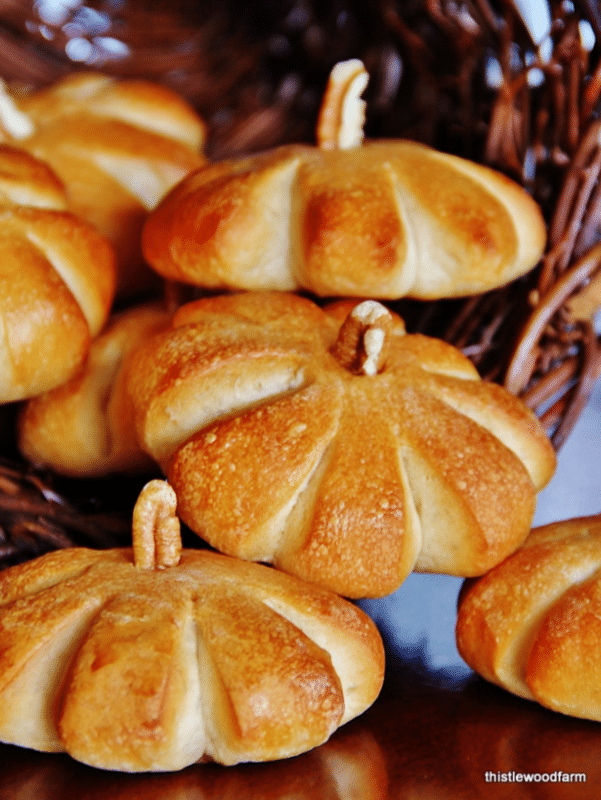 Pumpkin shaped rolls topped with butter and baked to perfection.