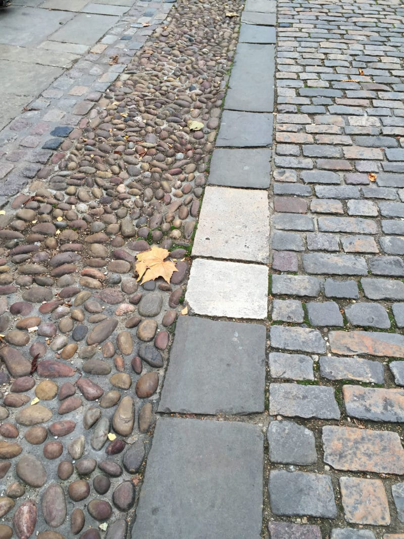 Historical cobblestone road in Oxford, UK.