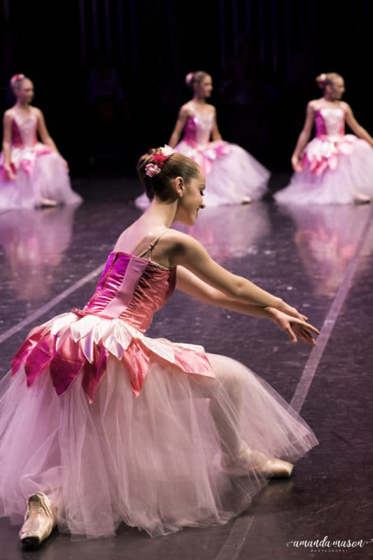 A beautiful flower dancer bowing down in The Nutcracker Waltz of Flowers.