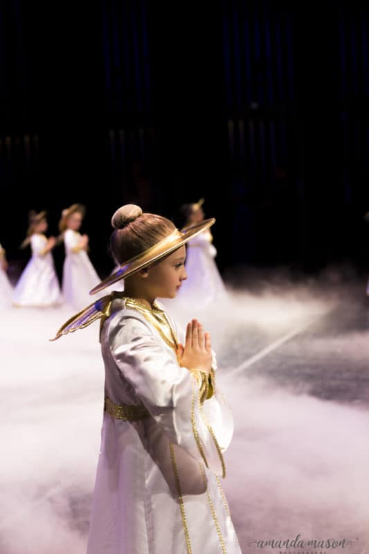 An angel praying in The Nutcracker, fog on stage.