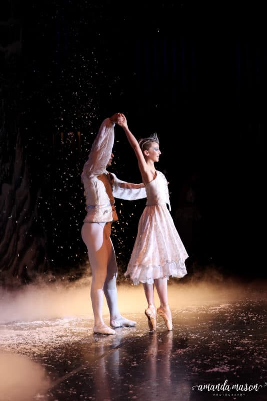 The Snow Queen dancing while the snow falls in The Nutcracker.