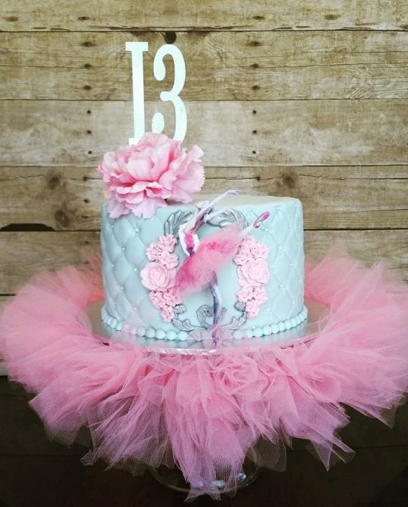 Blue and pink 13th birthday Ballerina birthday cake with pink tutu.