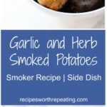 White bowl containing Garlic and Herb Smoked Gemstone Potatoes topped with fresh parsley.