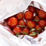 Foil packet containing cherry marinated tomatoes.