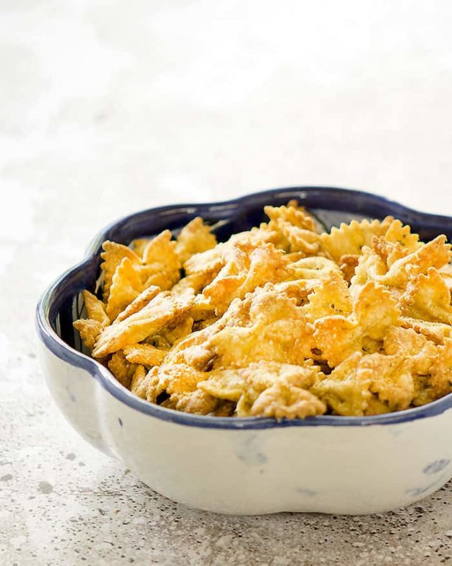 White bowl containing Air Fryer Bow Tie Pasta Chips.