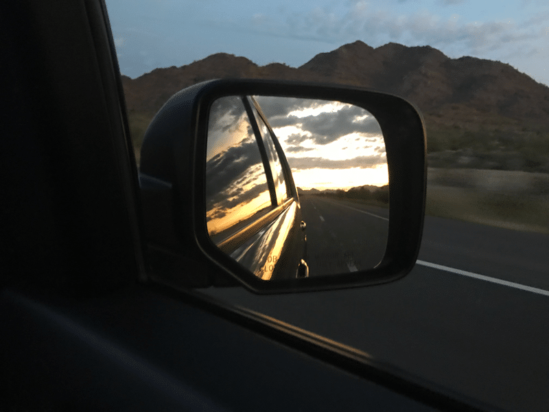 Arizona sunset in a car rearview mirror.