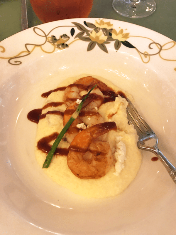 Sauteed Gulf Shrimp and Grits on a white plate on the Disney Wonder Cruise.
