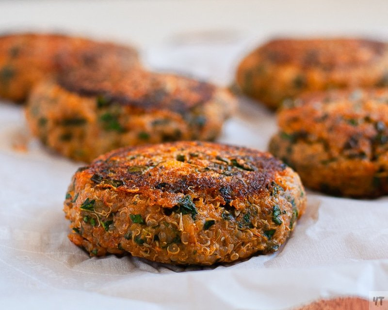 Five Sweet Potato and Kale Patties sitting on Parchment paper.