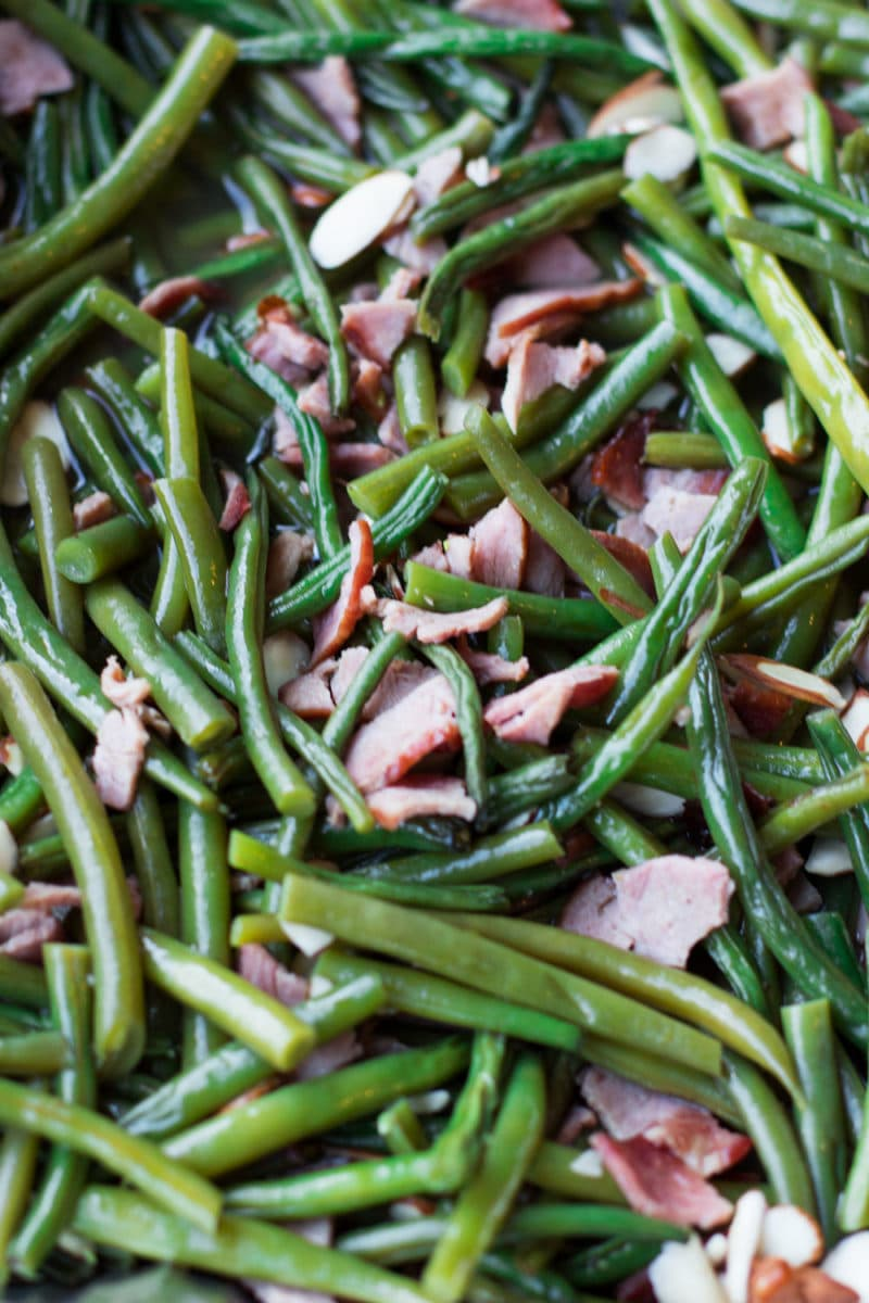 Smoked green beans topped with bacon and almonds.