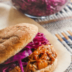 Mango BBQ pulled jackfruit sandwich topped with a tangy coleslaw.