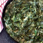 Cast iron skillet containing creamed spinach.