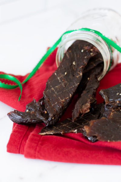 Dehydrated beef jerky on a white counter.