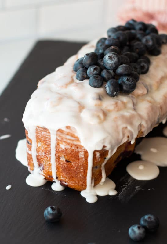 Lemon Blueberry bread topped with lemon glaze and blueberries.