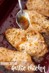 Garlic brown sugar sauce being dripped onto baked chicken breasts.