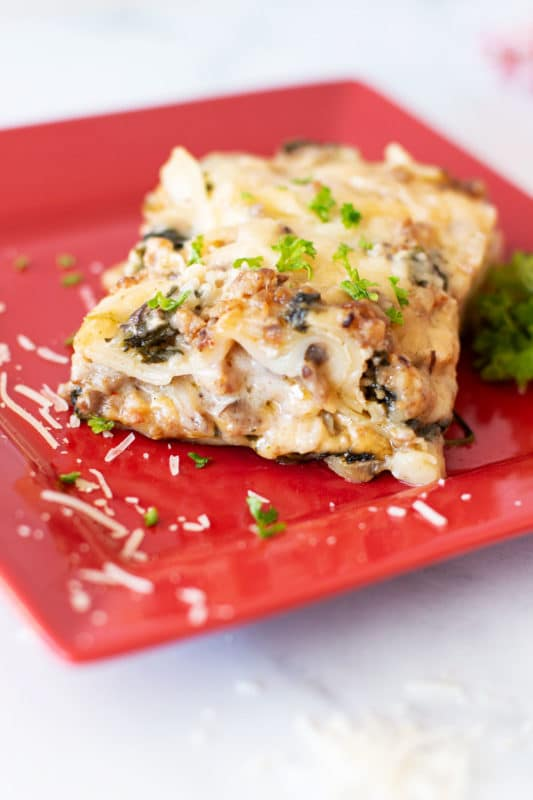 Slice of Creamy Spinach and Mushroom White Lasagna.