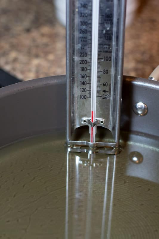 Candy thermometer in oil.