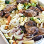 Baked chicken thighs recipe with vegetables for a sheet pan dinner.