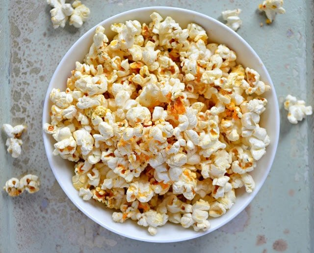 Buffalo ranch seasoned popcorn in a white bowl.