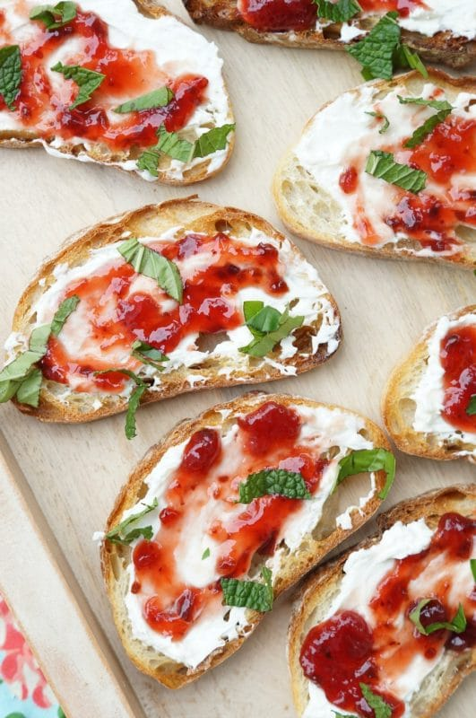 crostini with strawberry preserve, cheese and mint.