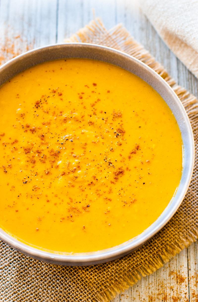 sweet potato soup in white bowl.