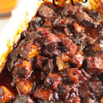 Smoked burnt ends in a white dish in BBQ sauce.