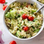 White bowl containing orzo pasta salad.