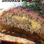 sliced meatloaf stuffed with cheese topped with parsley.